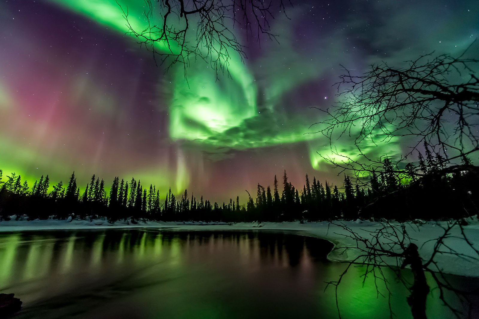 Northern Lights on a lake [Photo: Markus Kiili]